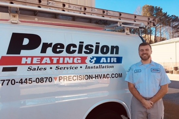 Hvac Technician Installer Standing In Front Of Company Van